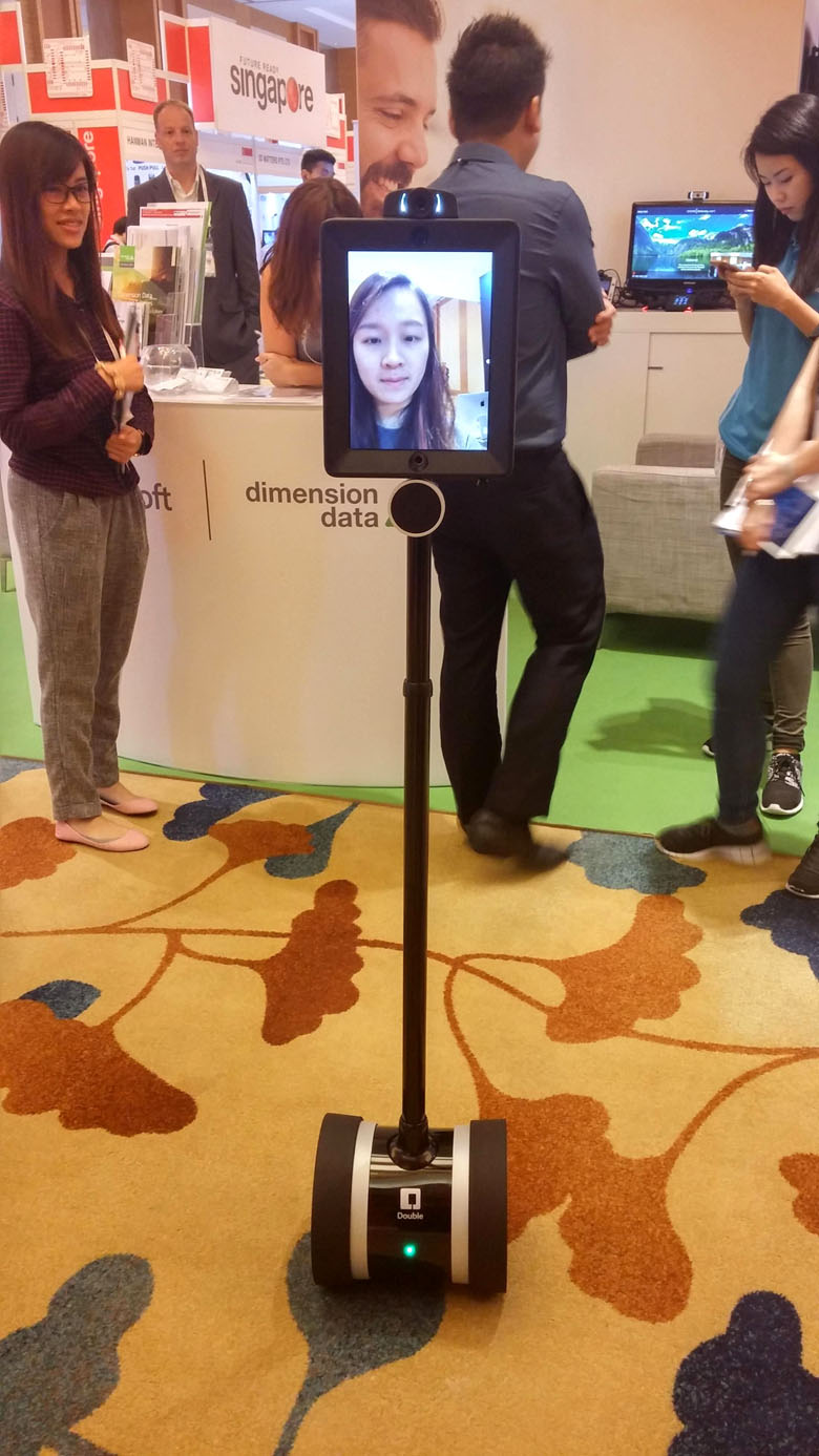 TALK TO THE STICK: Seen roaming the CommunicAsia show floor: the Double 2 telepresence robot, which allows people to walk around the office and have a videoconference call at the same time.